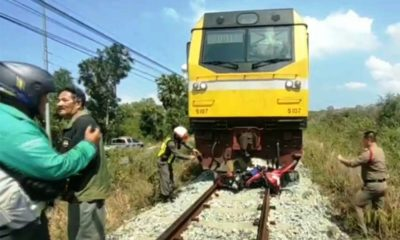 motorcycle hit by train in pattaya
